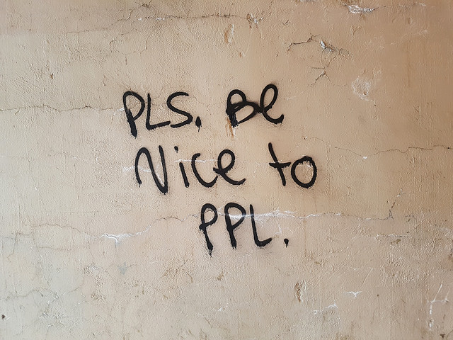 Graffiti reading 'Please be nice to people'.