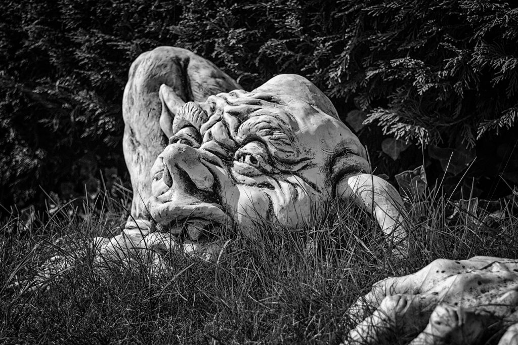black and white picture of a troll emerging from the ground