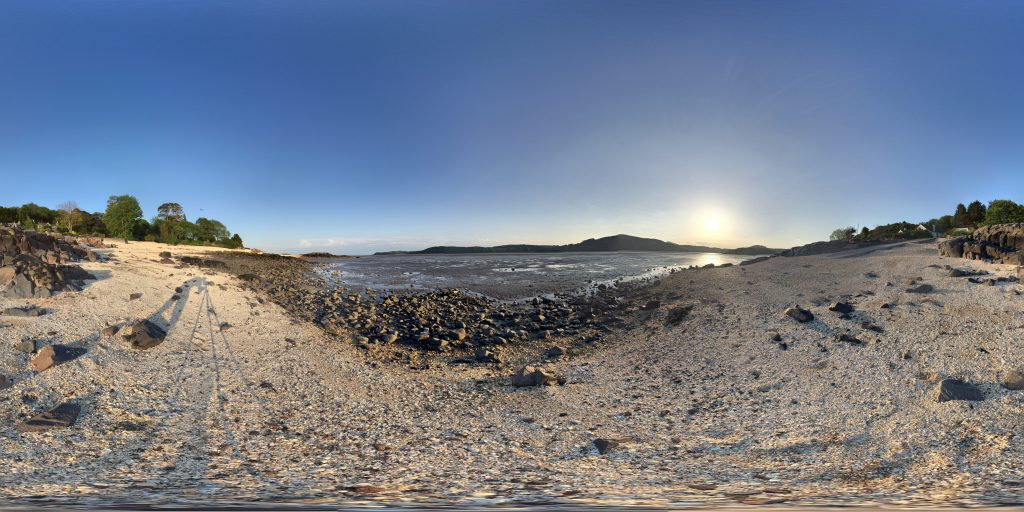 A flattened out 360 image of a beach in the evening sun