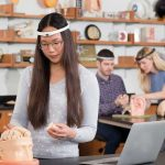 Students wearing head-mounted brain monitoring devices