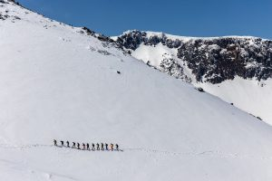Mountain climbers in a white landscape